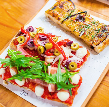 TAGLIO - PIZZA AL CORTE Restaurante - Reserva y Pide Delivery o Take Out en restaurantes de Comida DE AUTOR - BARRANCO - MESA 24/7 | LIMA - Perú